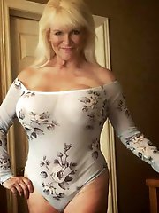 Gorgeous mature woman having fun